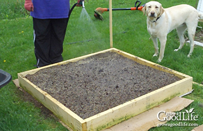image of a square foot garden filled with fresh soil)