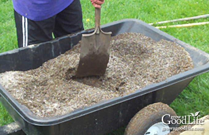 image of mixing soil in a garden cart