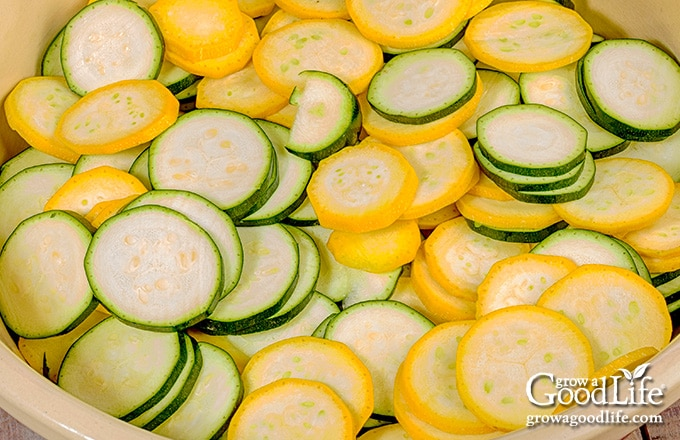 sliced green and yellow zucchini in a bowl