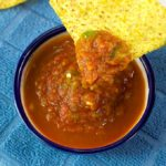 This garden fresh salsa recipe takes advantage of seasonal ingredients. It is so easy to make, just toss the ingredients into a food processor or blender, pulse it to the consistency you like, and enjoy.