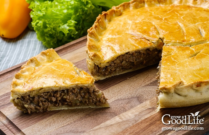 baked tourtiere on a table)