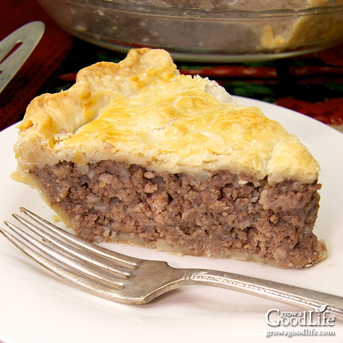 slice of tourtiere meat pie on a white plate