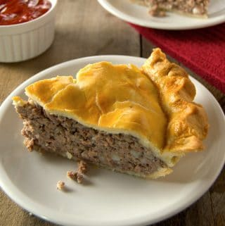 Tourtière, also known as pork pie or meat pie, is a traditional French-Canadian pie enjoyed throughout Canada and New England. It is made from a combination of ground meat, onions, savory seasonings, and baked in a traditional piecrust.