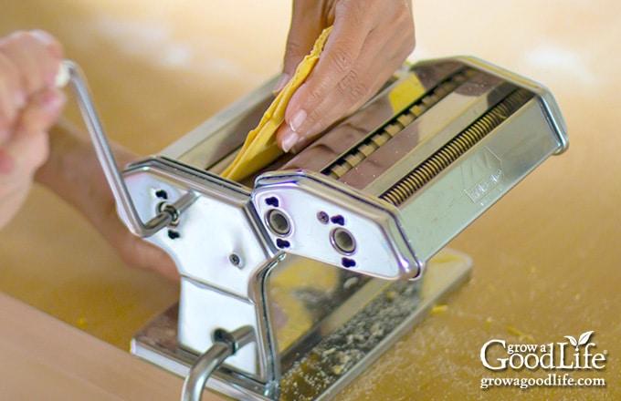 running the dough through a manual pasta machine