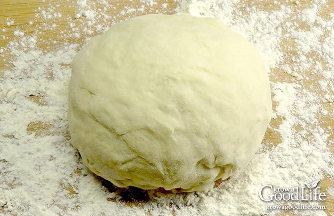 tortilla dough on a floured board
