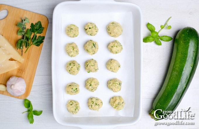 zucchini balls in a baking pan