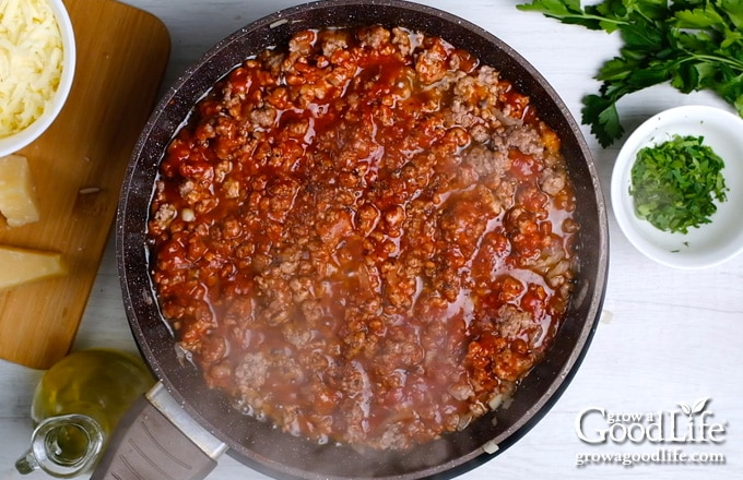 cooking meat sauce in a skillet