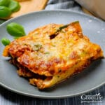 piece of zucchini lasagna on a grey plate