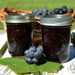 Make and preserve your own homemade Concord grape jelly! Concord grapes have a slightly tart, musky flavor but can be transformed into a delicious grape jelly with a little sweetening. This old-time favorite is sweetened with honey in this recipe.