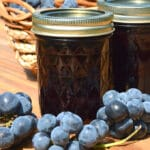 jars of grape jelly on a table