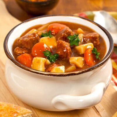 white bowl of beef stew on a table