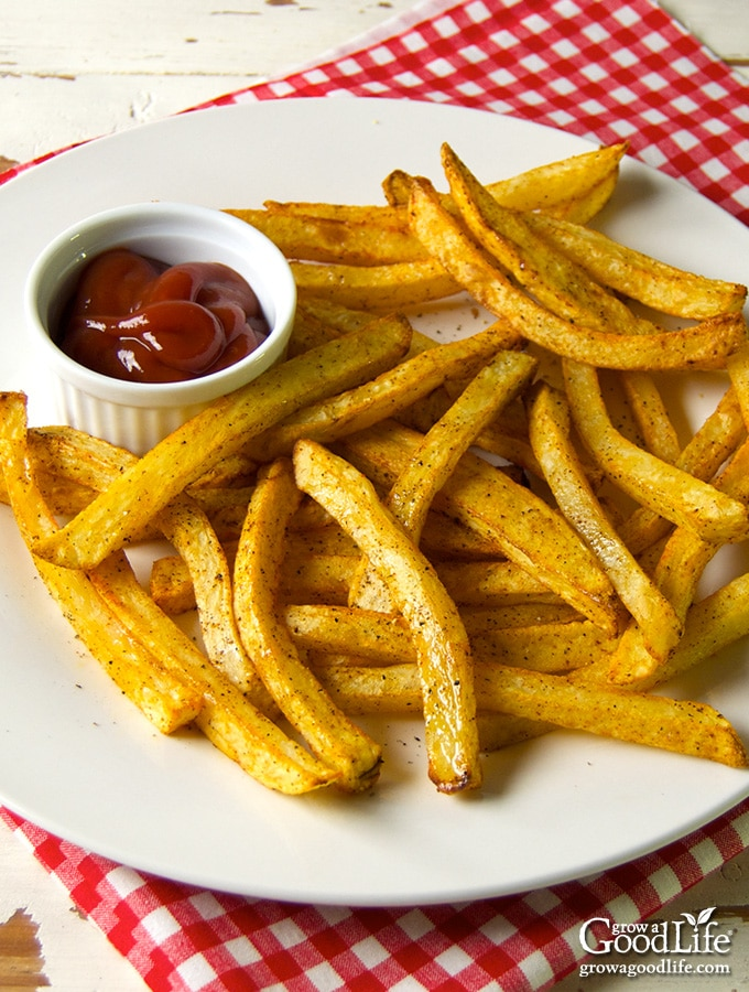 Yes, you can make crispy seasoned baked French fries at home without deep-frying in vegetable oil. Instead, make your own hand cut homemade baked fries!
