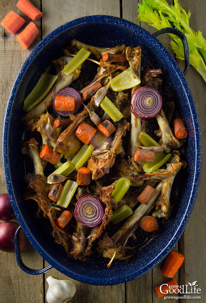 Make use of the whole bird by turning the bones into a delicious rich turkey stock that is perfect for gravy, soup, or stew. Roasting the bones first, along with the veggies, will result in a richer flavor. Then add everything into the stockpot and simmer into a tasty stock.