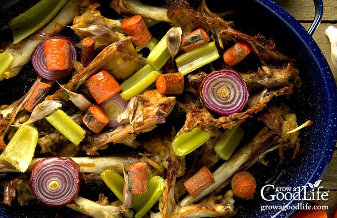 roasting pan filled with turkey stock ingredients