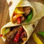 These sizzling beef steak fajitas are made with strips of steak infused with a flavorful chili-lime marinade, combined with colorful peppers, onions, and folded into a warm tortilla.