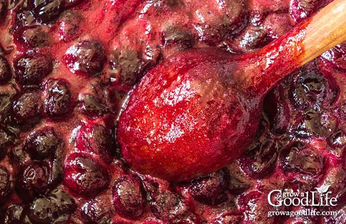 closeup of cherries simmering into jam