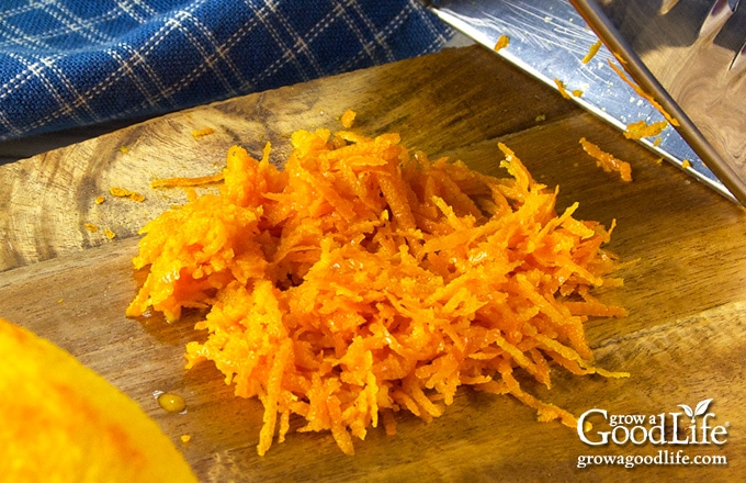 a pile of fresh orange zest on a cutting board