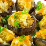 These garlic and cheddar stuffed mushrooms are a great appetizer for parties, cocktail hour, or game day. Baby bella mushrooms filled with garlic and cheddar stuffing and topped with cheddar cheese. Try this garlic and cheddar stuffed mushrooms recipe for a flavorful, bite-sized appetizer!