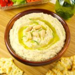 This simple recipe for white bean dip is filled with flavor. Begin with Cannellini beans, add roasted garlic, rosemary, olive oil, and brighten with lemon juice and zest. Puree to a smooth and creamy texture that pairs well with crackers and veggies.