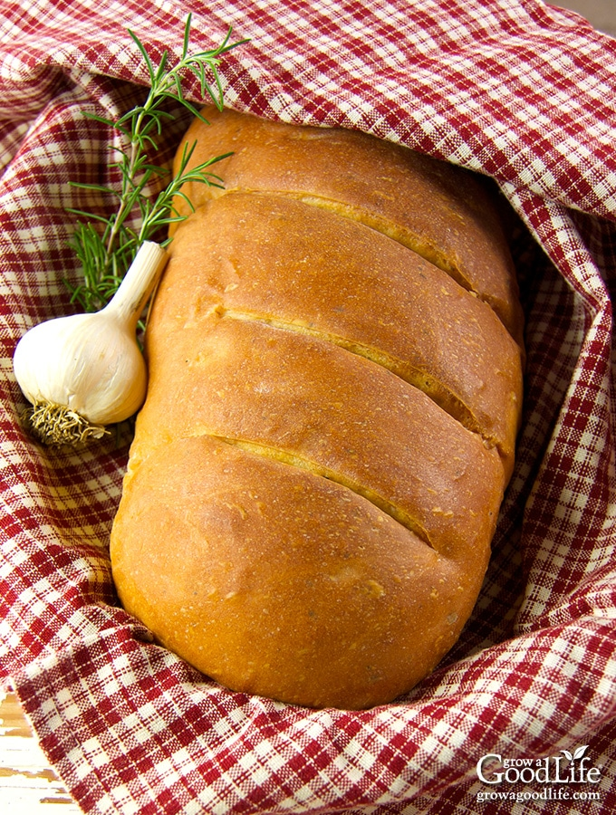 This garlic rosemary bread recipe has a whole head of roasted garlic baked into the dough. Oven roasting mellows the flavor of garlic and the soft, roasted cloves vanish into the bread dough giving you a mild garlic flavor with each and every bite.