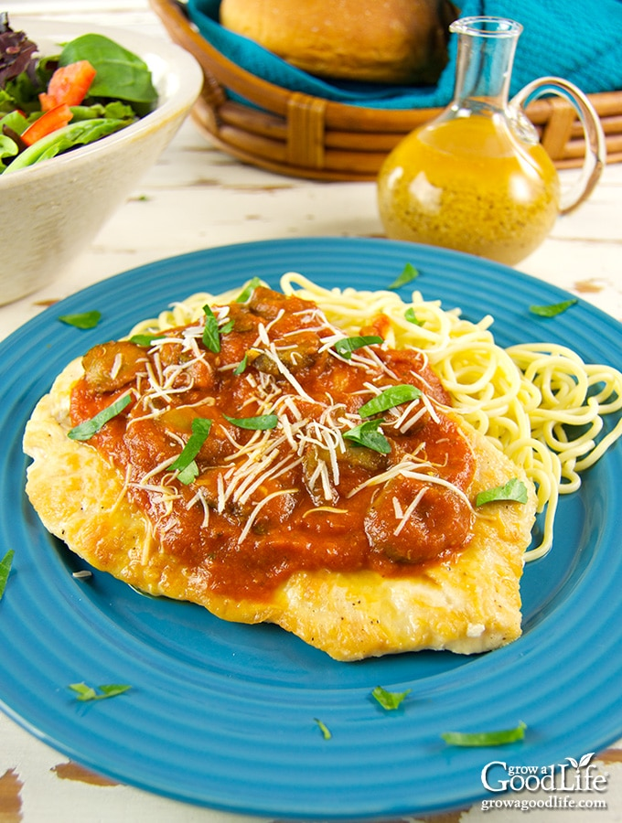 This chicken paillard dish is quick and easy to prepare at home. Thinly pounded, seasoned, and browned chicken cutlets smothered in a mushroom marinara sauce.