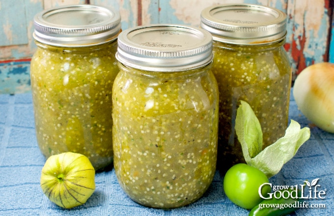 jars of tomatillo salsa verde on a table