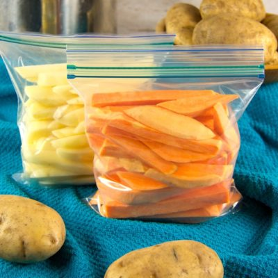 Whether you grow and store your own potatoes, purchase in bulk from the farmer' market, or snag a great deal at the supermarket, a day of prep can fill your freezer full of potato French fries ready to bake or air fry quickly for meals.