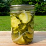 Pickle that big harvest of zucchini from your vegetable garden with this easy sweet and sour zucchini pickles canning recipe.