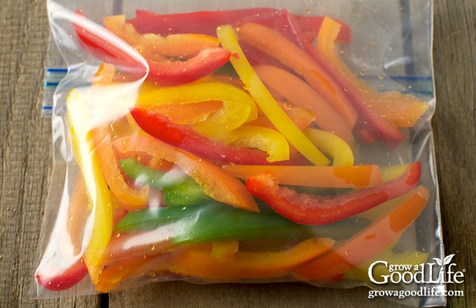closeup of a freezer bag filled with color bell pepper strips
