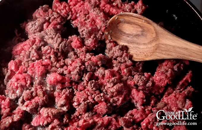 Add your ground beef to the skillet and cook it until brown. Drain the fat and add the cooked beef to your slow cooker crock.
