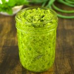 A slight twist from your regular pesto, this recipe combines garlic scapes with lemon balm for an early garden fresh variation. Spoon this garlic scape lemon balm pesto on pasta, seafood, and even sandwiches.