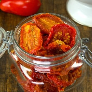 No sunshine required to make these homemade sun dried tomatoes. Drying tomatoes is a great way to preserve the harvest and save storage space. 20 pounds of tomatoes will reduce down to about one pound of sun dried tomatoes.
