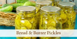 jars of bread and butter pickles on a white table