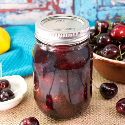 jar of canned bourbon cherries on a table
