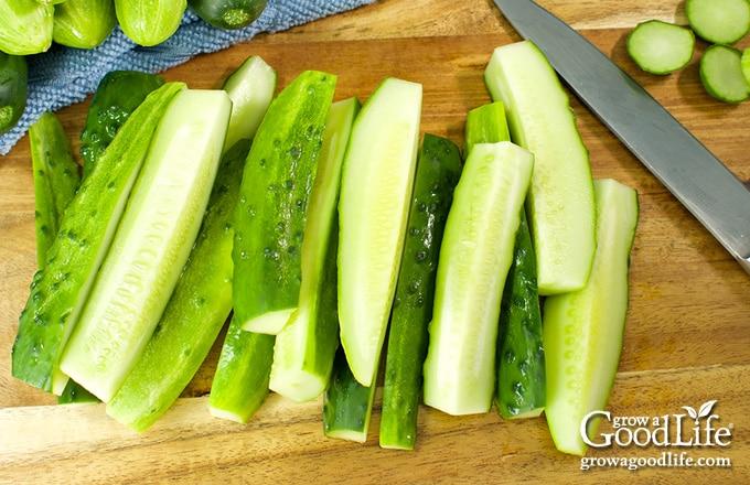 cucumber spears on a cutting board