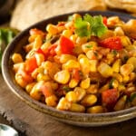 closeup of a bowl of corn salsa on a table