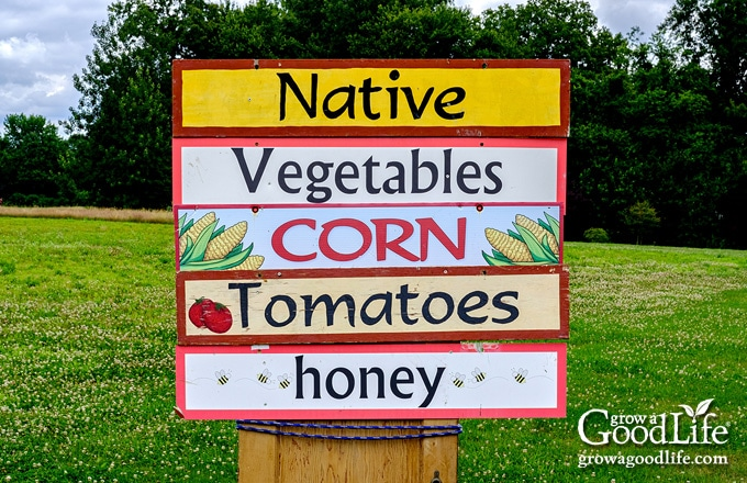 farm stand sign announcing corn is available