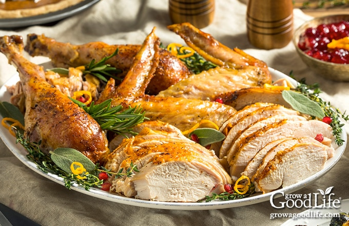 platter of carved turkey on a table