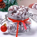 jar of chocolate crinkle cookies with christmas decorations