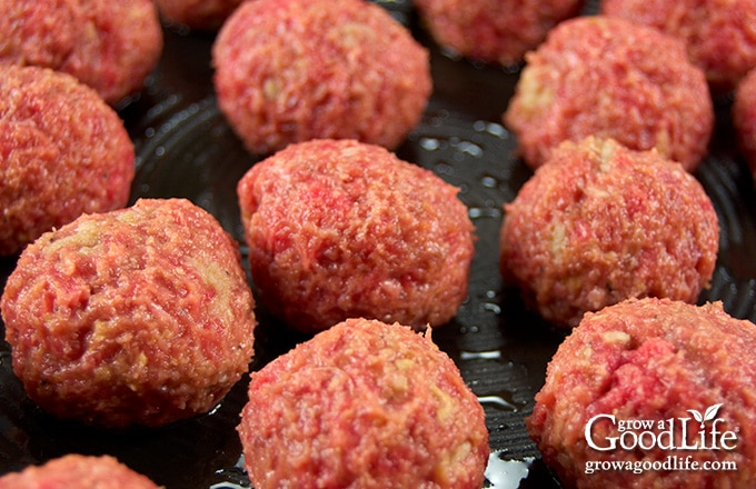 image of meatballs cooking in a skillet