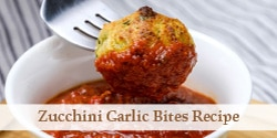dipping zucchini garlic bite into tomato sauce