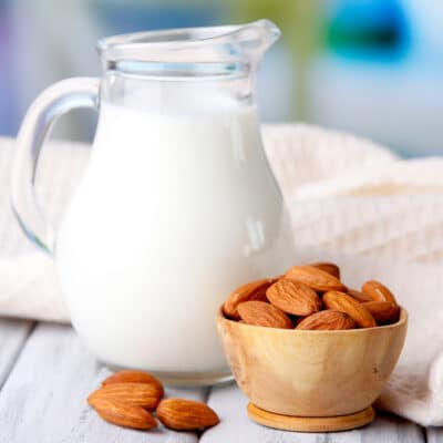 almond milk in a glass pitcher on a table