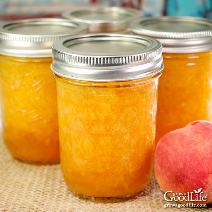 jars of peach jam on a table