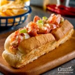 closeup of a Maine lobster roll in a toasted bun