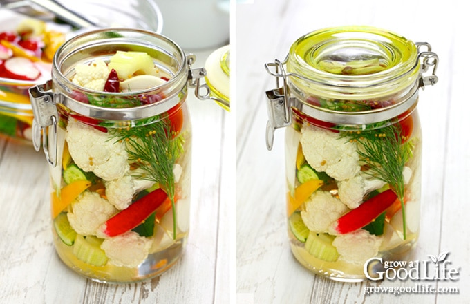 filling a jar of mixed vegetables with pickling brine