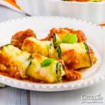 cheese zucchini roll ups on a white plate