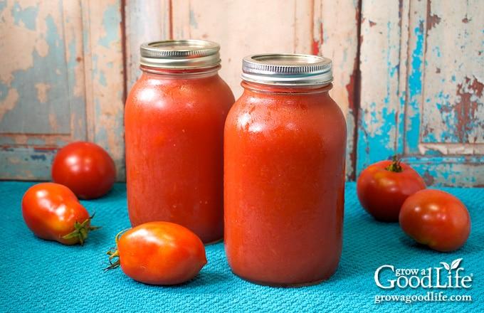 quart jars of tomato puree on a table